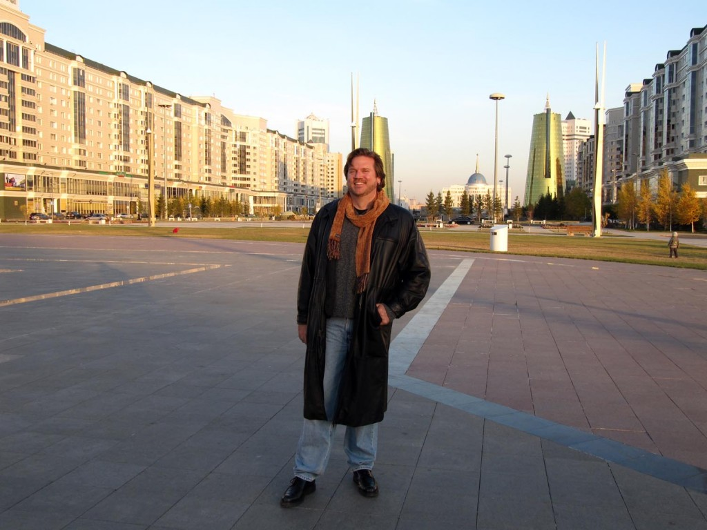 It's pretty chilly here; not snowing yet, but it's thinking about it - thus the heavy clothes. Also, behind me is the new Presidential Palace.