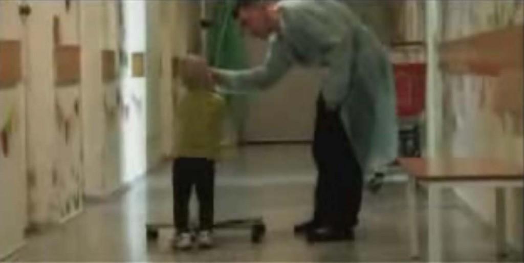 tiny child pulling adult-size IV around